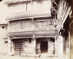 Front of a banya's house, Patan, showing elaborate wood carving on upper storey